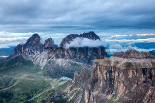 Cloudy and foggy sunrise at Dolomites mountains