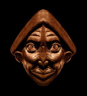 Wood Scuplture Mask in Black Background
