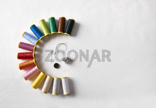 spools of thread in semicircle