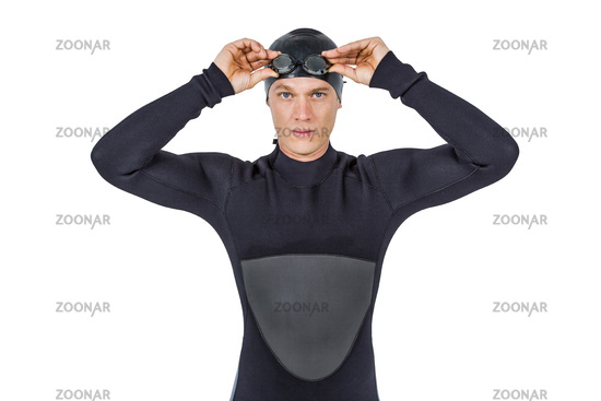 Swimmer in wetsuit wearing swimming goggles