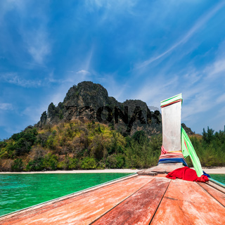 Traveling at Thai traditional boat. Thailand tropical beach landscape