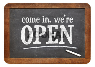 Come in, we are open blackboard sign