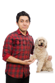 Young man with dog isolated on white