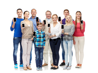 group of smiling people with smartphones