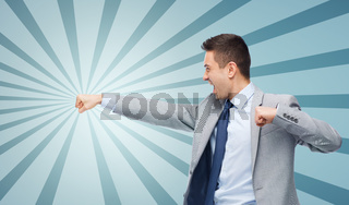businessman in suit fighting with someone