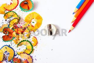 varicolored pencil, shavings and sharpener
