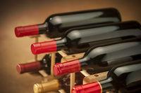 Close up of wine bottles on a rack