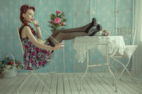 Pin-up girl sitting at the table