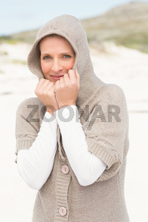 Smiling woman standing on the sand