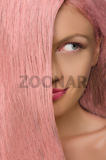 woman with pink hair looking to side