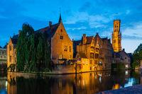 Night scene of Rozenhoedkaai and Belfort Tower in Brugge Belgium