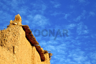 africa  in histoycal maroc    construction  and the blue cloudy  sky