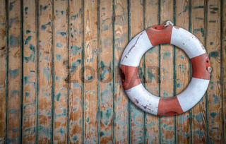 Rustic Lifebuoy On Wall