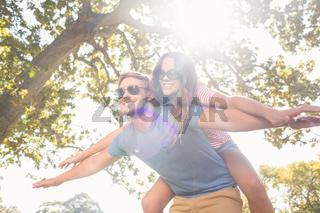 Cute couple having fun in park