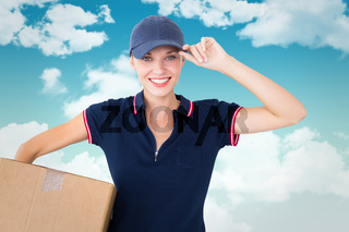 Composite image of happy delivery woman holding cardboard box