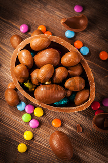 Assorted chocolate for Easter on wooden background