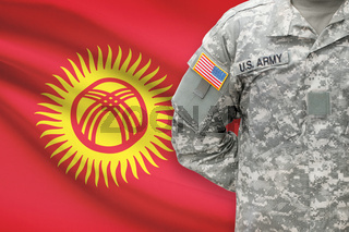 American soldier with flag on background - Kyrgyzstan