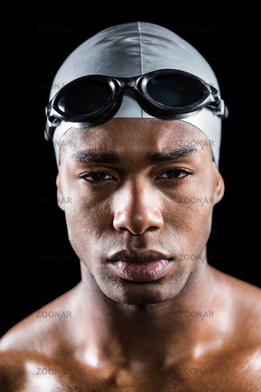 Portrait of swimmer in swimminggoggles and swimming cap