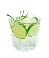 Lemonade with cucumber and rosemary in glass
