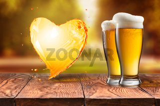 Love beer. Beer in glass with heart splash on wooden table again