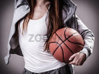 Sporty girl holding basketball