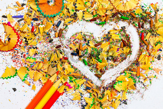 heart, three pencils and colored wooden shavings