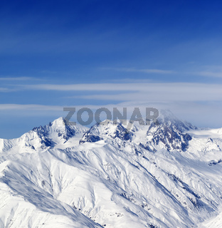 Sunny slopes of winter mountains