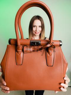 stylish woman fashion girl holding brown handbag