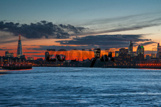 Shard and City of London from River Thames at Sunset, London, UK