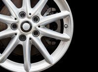 Silver modern car wheel on black background