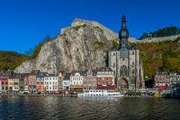 Old buildings, citadelle on rock, landmark church in Dinant Belgium