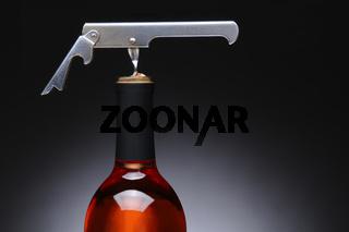 Corkscrew in Red Wine Bottle