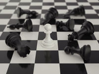 Pawn in the surrounded of black chess pieces