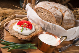 homemade bread with cream and tomato