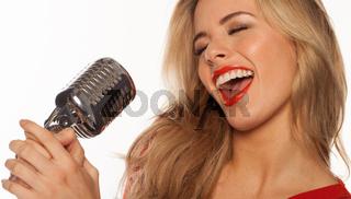 sexy blonde singer singing