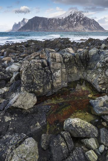 mountains and stony beach, Lofoten, Norway