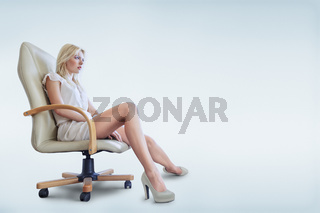 Young woman sitting in armchair