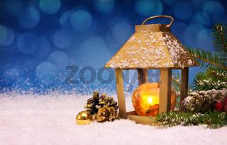 Christmas lantern on white snow.