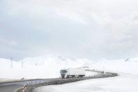 Car in a snow mountains