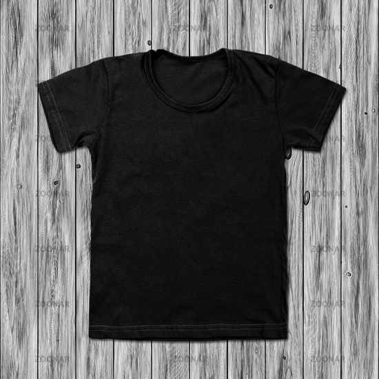 Black blank t-shirt on wood background