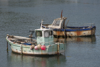 Two old fishing boats in 'Le Relais du Vieux Port'.