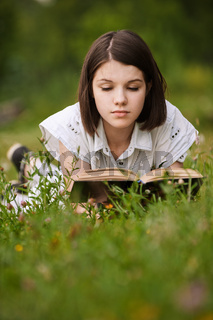 young beautiful grand woman reading book