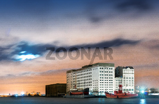 Millenium Mills, Royal Victoria Dock in the mooonlight, Docklands, London, United Kingdom
