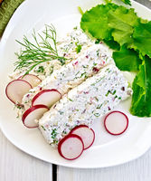 Terrine of curd and radishes in dish on board top