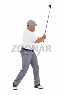 Golf player taking a shot