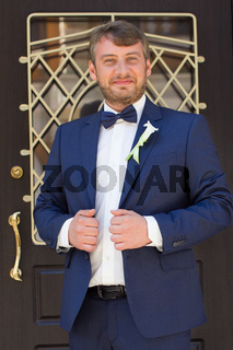 Unshaven groom in a blue suit
