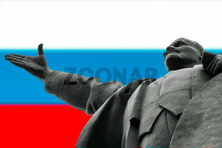 Metal statue of the old and very famous Russian Leader Lenin against the Russian flag
