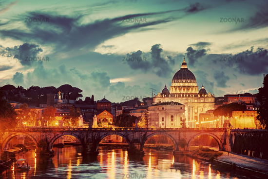 St. Peter#39;s Basilica, Vatican City.  Tiber river in Rome, Italy at late sunset, evening.