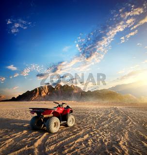 Quad bike in desert