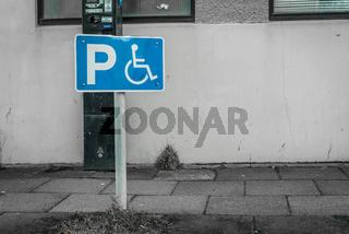 Handicap parking sign on a street